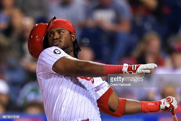 Maikel Franco of the Philadelphia Phillies swings out of his helmet in the ninth inning against the New York Mets at Citizens Bank Park on April 12...
