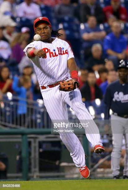Maikel Franco of the Philadelphia Phillies throws to first base after fielding a ground ball in the third inning during a game against the Atlanta...