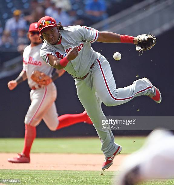 Maikel Franco of the Philadelphia Phillies throws to first but is unable to get the out on a single hit by Wil Myers of the San Diego Padres during...