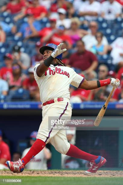 Maikel Franco of the Philadelphia Phillies watches as he hits a game winning walkoff home run against the Washington Nationals during ninth inning of...