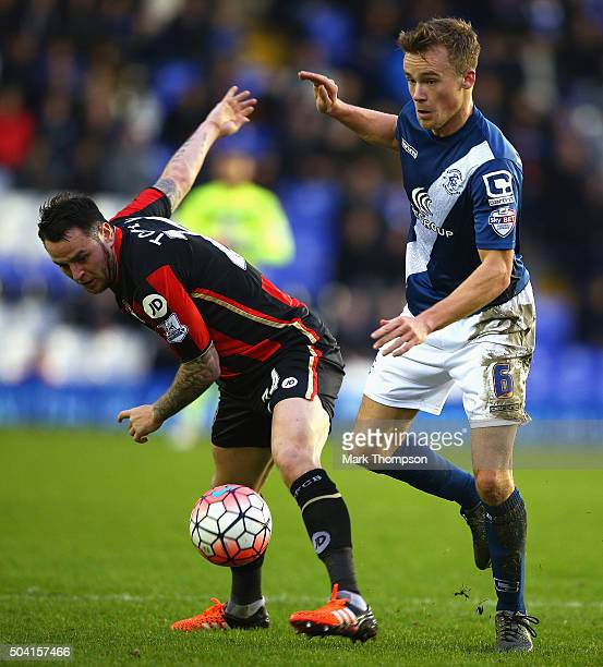 Maikel Kieftenbeld of Birmingham City and Lee Tomlin of Bournemouth compete for the ball during the Emirates FA Cup Third Round match between...