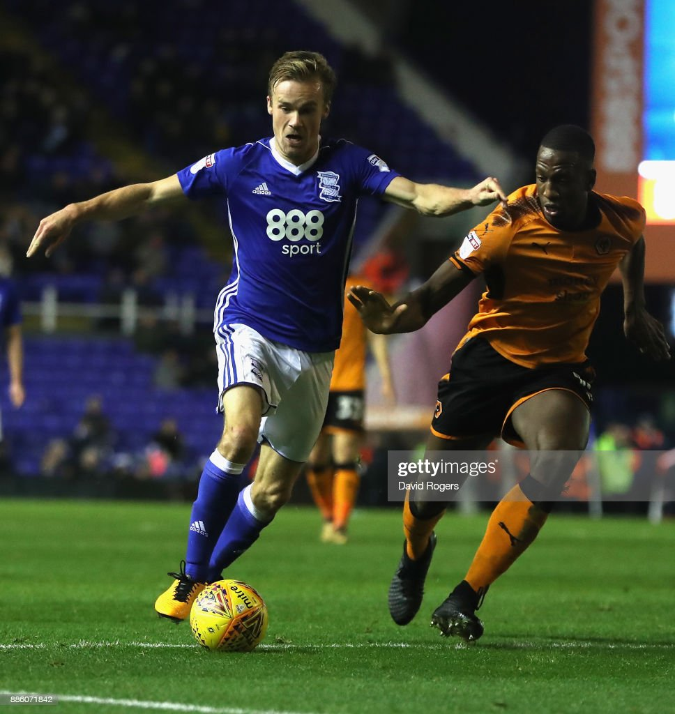 Maikel Kieftenbeld of Birmingham moves away from Willy Boly during the Sky Bet Championship match between Birmingham City and Wolverhampton Wanderers at St Andrews on December 4, 2017 in Birmingham, England.