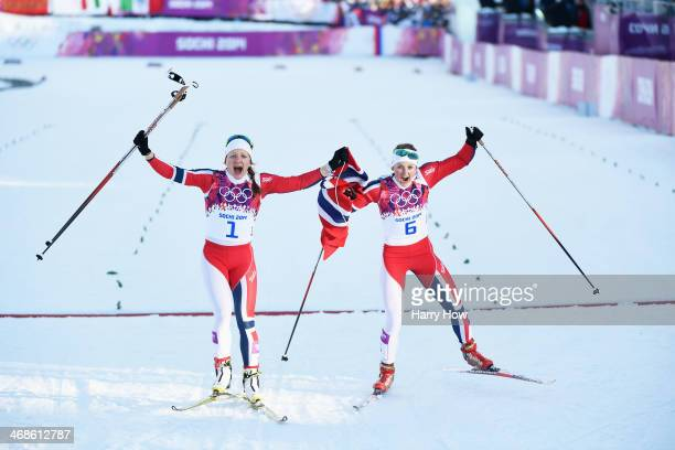 Maiken Caspersen Falla of Norway and Ingvild Flugstad Oestberg of Norway celebrate winning first and second place in the Finals of the Ladies' Sprint...