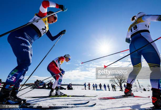 Maiken Caspersen Falla of Norway and Jessica Diggins of the United States compete in the Women's 10km freestyle pursuit during the FIS Cross Country...