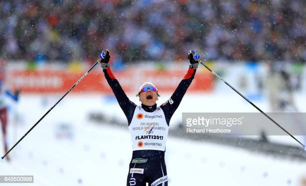 Maiken Caspersen Falla of Norway celebrates the 1st place in the Men's and Women's Cross Country Team Sprint Final during the FIS Nordic World Ski...