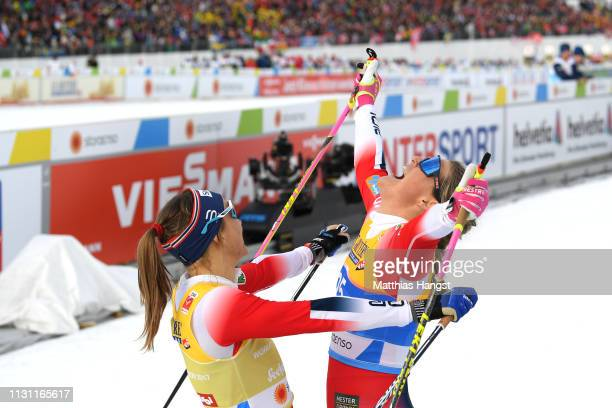 Maiken Caspersen Falla of Norway celebrates victory with Marie Eide of Norway in the Women's Cross Country Sprint Final at the Stora Enso FIS Nordic...