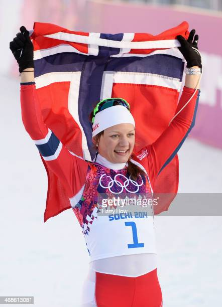 Maiken Caspersen Falla of Norway celebrates winning the Finals of the Ladies' Sprint Free during day four of the Sochi 2014 Winter Olympics at Laura...