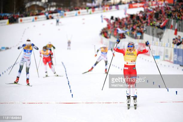 Maiken Caspersen Falla of Norway crosses the finish line as she celebrates victory in the Women's Cross Country Sprint Final at the Stora Enso FIS...