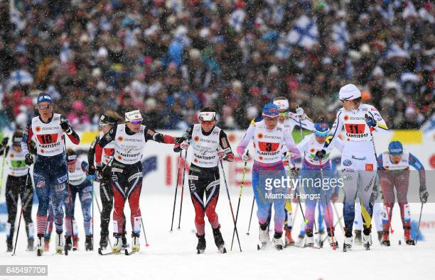 Maiken Caspersen Falla of Norway hands over to team mate Heidi Weng in the Men's and Women's Cross Country Team Sprint Final during the FIS Nordic...