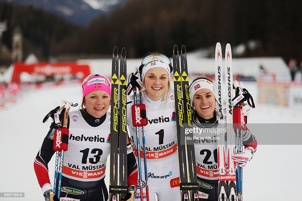 Maiken Caspersen Falla of Norway, Stina Nilsson of Sweden and Heidi Weng of Norway celebrates during the women's Sprint F race on December 31, 2016 in Val Mustair, Switzerland.