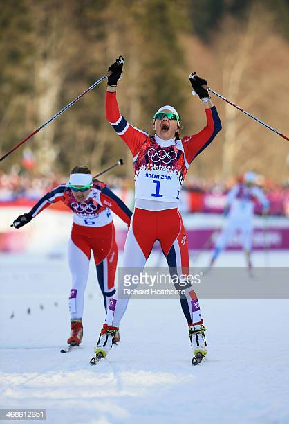 Maiken Caspersen Falla of Norway wins the Finals of the Ladies' Sprint Free during day four of the Sochi 2014 Winter Olympics at Laura Crosscountry...