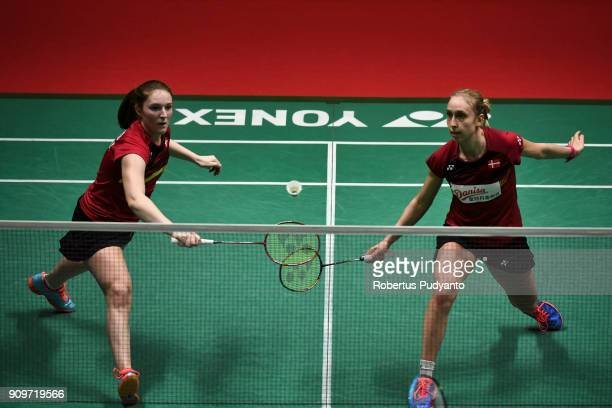 Maiken Fruergaard and Sara Thygesen of Denmark compete against Lin Xiao Min and Wu Fang Chien of Chinese Taipei during Women Doubles Round 32 match...