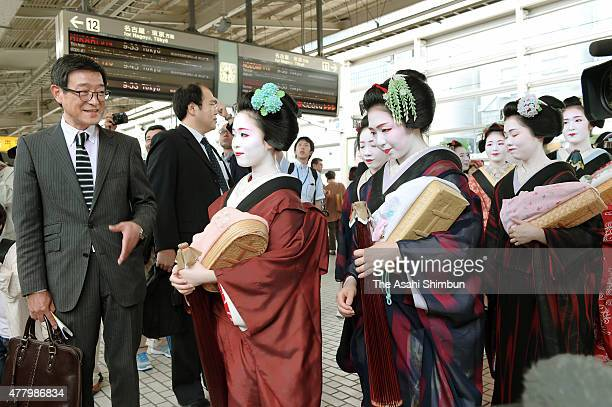 40 Maiko and Geiko are seen prior to get aboard a Shinkansen bullet train at Kyoto Station on June 21 2015 in Kyoto Japan Geikos are tour to Tokyo...