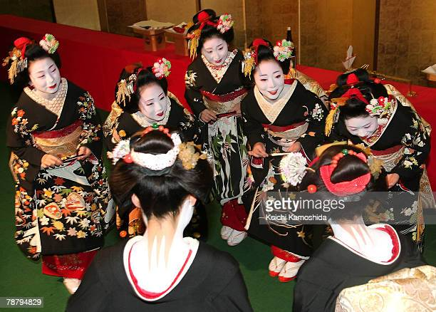 Maiko and Geiko attend a New Year's ceremony at the Gion Kobu Kaburenjo on January 7 2008 in Kyoto Japan The traditional culture is still practiced...