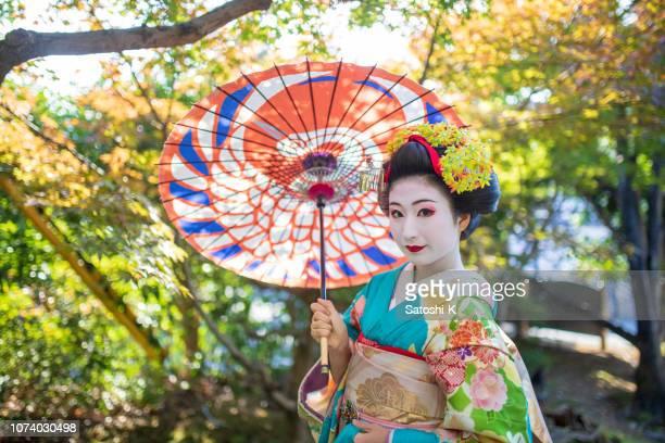 Maiko Apprentice Geisha posing in nature