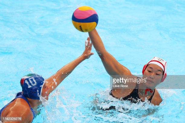 Maiko Hashida of Japan takes a shot against Valeria Palmieri of Italy during their Women's Water Polo Preliminary round match on day four of the...