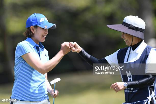 Maiko Wakabayashi of Japan celebrates after making her birdie putt on the 1st hole during the first round of the CyberAgent Ladies Golf Tournament at...