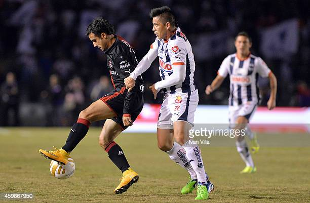 Maikon Leite of Atlas fights for the ball with Efrain Velarde during a quarterfinal first leg match between Monterrey and Atlas as part of the...