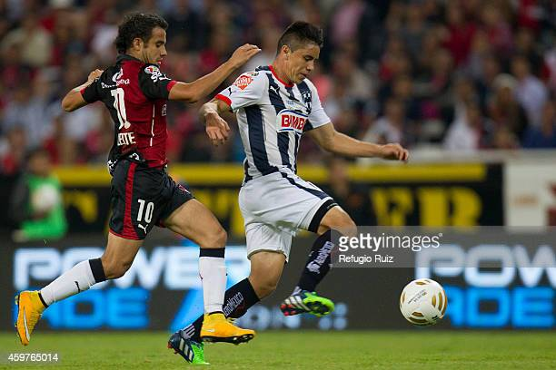 Maikon Souza of Atlas fights for the ball with Efraín Velarde of Monterrey during a quarterfinal second leg match between Atlas and Monterrey as part...