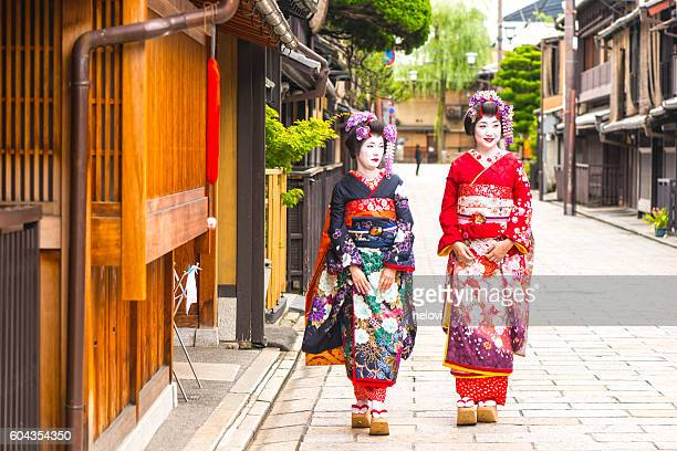Maikos walking in old part of Kyoto