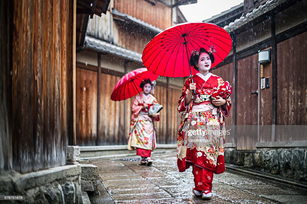 Maikos walking in the streets of Kyoto : Stock Photo