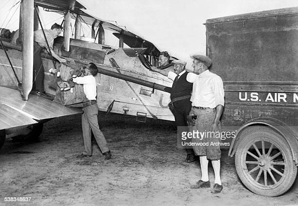 Mail being loaded into the first plane to take off from Hadley Field for the Night Air Mail Service between New York and Chicago, New Brunswick, New...