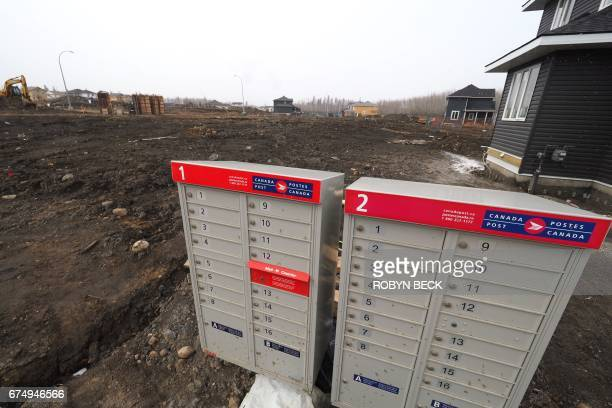 Mail boxes are seen beside empty home lots in a residential neighborhood which has yet to be rebuilt after a devastating fire one year ago in Fort...
