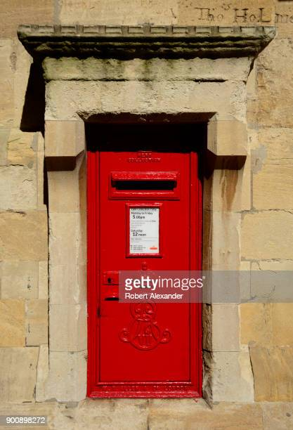 A mail collection box at Windsor Castle in Windsor England in embellished with the royal cypher or monogram of King George VI who ruled from 1936...