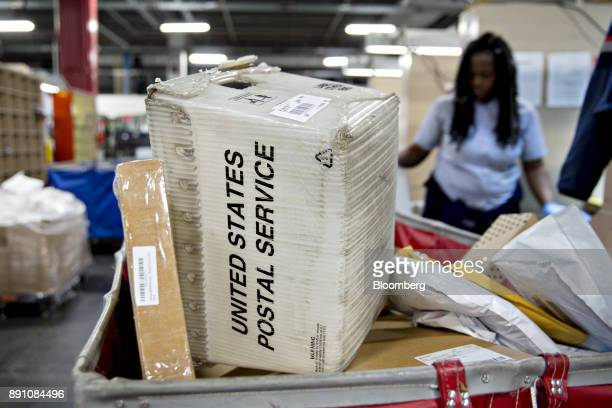 A mail crate sits in a package bin at the United States Postal Service Joseph Curseen Jr and Thomas Morris Jr processing and distribution center in...