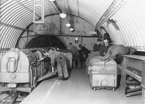 Mail in containers being loaded into a train at Mount Pleasant depot London 9th February 1928
