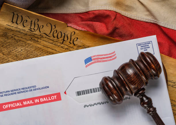 2020 mail in election envelope and judges gavel and American flag and Constitution