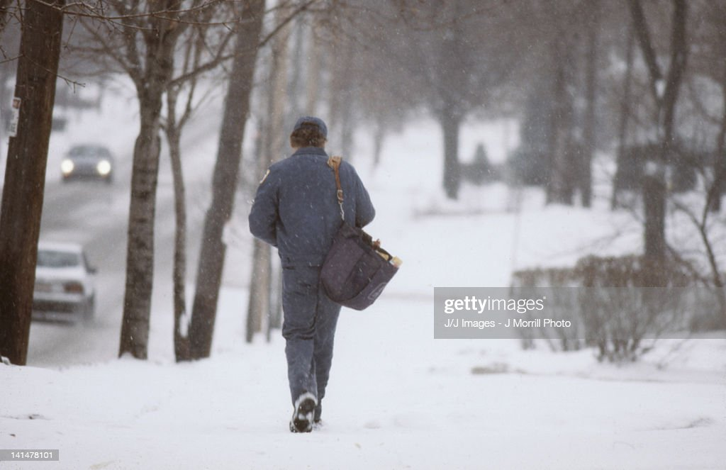 mail man in snow storm : Foto de stock