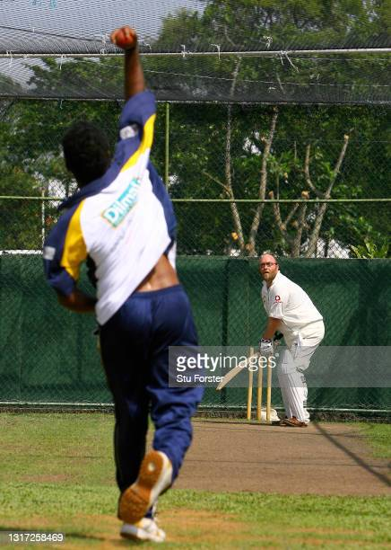 Mail on Sunday Cricket journalist Peter 'Reggie' Hayter in action in the nets with Sri Lanka spin bowler Muttiah Muralitharan at the Colombo CCC on...