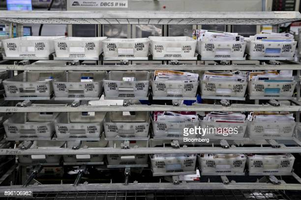 Mail sits in trays at the United States Postal Service Suburban processing and distribution center in Gaithersburg Maryland US on Tuesday Dec 19 2017...