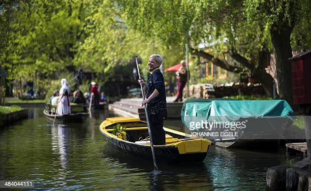 Mail woman Andrea Bunar delivers letters from boat in luebbenau village in Spreewald south of the German capital Berlin on April 11, 2014. The German...