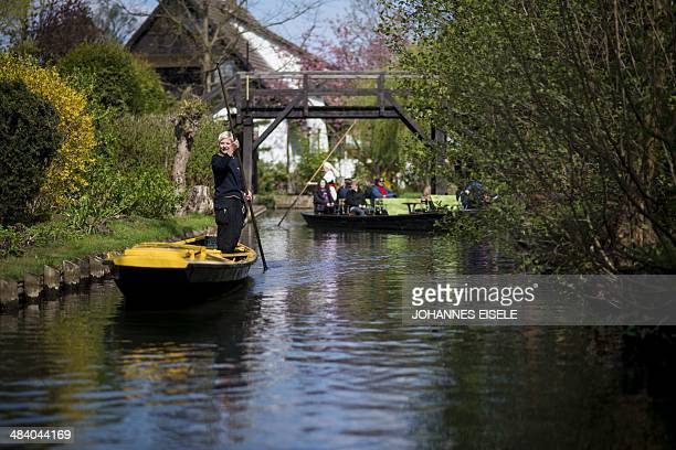Mail woman Andrea Bunar delivers letters from boat in luebbenau village in Spreewald south of the German capital Berlin on April 11 2014 The German...