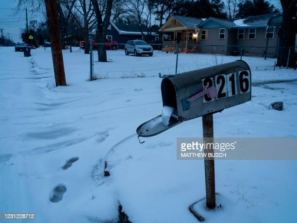 Mailbox is seen frozen in a snow covered neighborhood in Waco, Texas as severe winter weather conditions over the last few days has forced road...