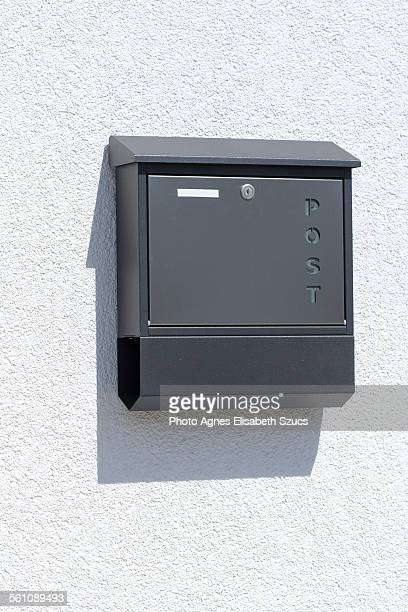 mailbox & newspaper holder box & shadow - domestic mailbox stock pictures, royalty-free photos & images