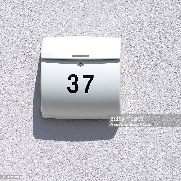 Mailbox number 37 with shadow square