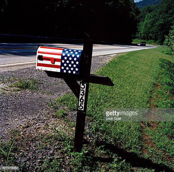 Mailbox on the road leading into Robbinsville North Carolina a typical roadside view when driving through the US The US flag painted on the mailbox...