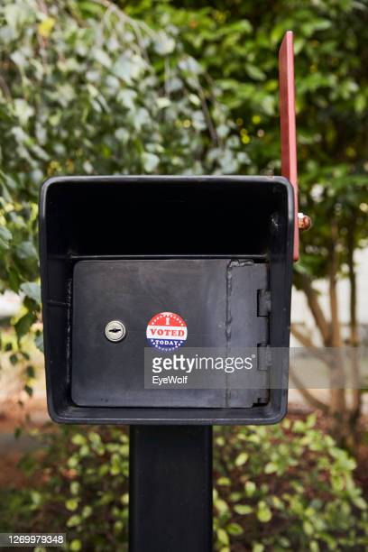 """a mailbox outside a house with a """"i voted today"""" sticker on it. - voting by mail stock pictures, royalty-free photos & images"""