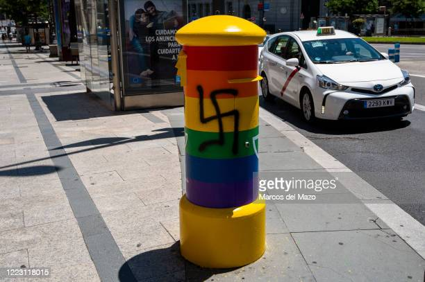Mailbox painted with the Rainbow LGTB colors appears vandalized with a graffiti of a swastika nazi symbol. The Spanish Postal Service has painted...