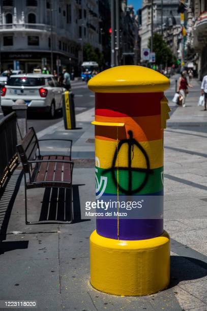 Mailbox painted with the Rainbow LGTB colors appears vandalized with a graffiti of a Celtic cross nazi symbol. The Spanish Postal Service has painted...