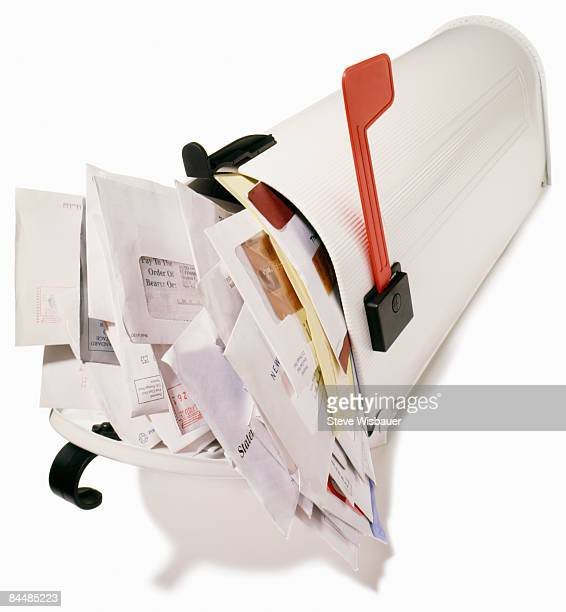 mailbox stuffed overflowing with bills,  junk mail - domestic mailbox stock pictures, royalty-free photos & images