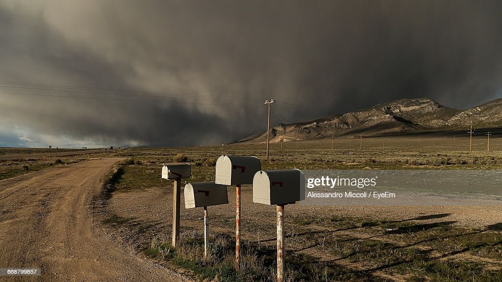 Mailboxes In Row On Dirt Road At Countryside Landscape : Stock Photo