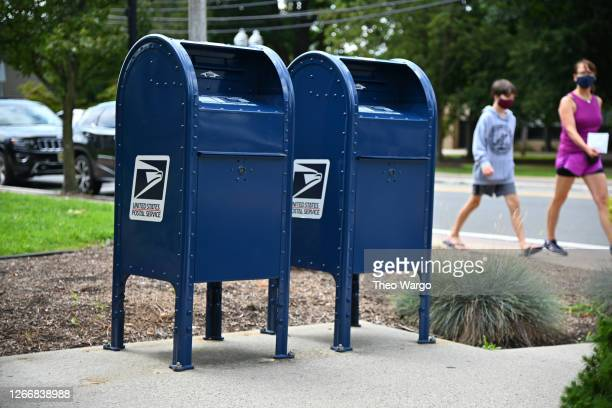 Mailboxes sit outside of a Morris Plains, NJ post office on August 17, 2020 in Morris Plains, New Jersey. Postmaster General Louis DeJoy has accepted...