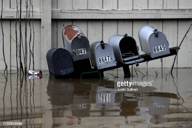 Mailboxes sit under water in a flooded neighborhood on February 27 2019 in Forestville California The Russian River has crested over flood stage and...