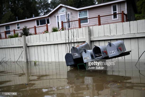 Mailboxes sit underwater in a flooded neighborhood on February 27 2019 in Forestville California The Russian River has crested over flood stage and...