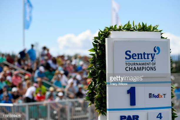 Maile lei hangs on the first tee signage during the first round of the Sentry Tournament of Champions on the Plantation Course at Kapalua on January...