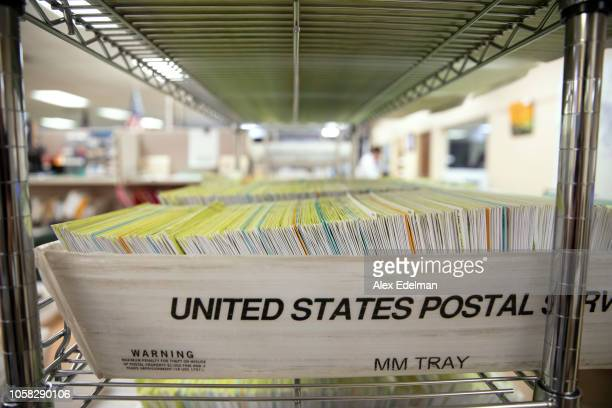 Mailed in ballots sit in US Postal Service bins inside the office of the Stanislaus County Clerk on November 6 2018 in Modesto California Stanislaus...